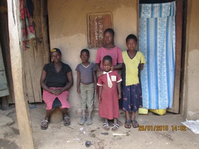 Winnie (in yellow shirt) is in Primary 6. She has lost both parents and stays with an uncle and 5 cousins in a one room home.